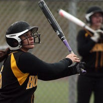 Hanover Park's Alex Cosenzo watches her 3-run-homer clear the right field fence at Morristown Beard. The homer would prove the game winner as Hornets won 9-5 in 9 innings. April 7, 2015.  Morristown, N.J. Bob Karp/Staff Photographer.