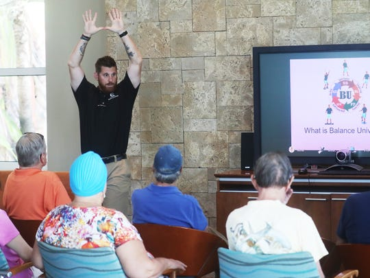 Chris Williams teaches a balance class at Blue Cross Blue Shield at Coconut Point on Friday 7/6/2018. He has written a book on balance called Balance University.