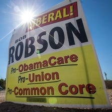 Conservative groups are targeting moderate Republicans in the upcoming primary by tying them on campaign signs to President Obama. This anti-Bob Robson sign is in Tempe on the corner of Warner and Rural roads, on Thursday, Aug. 7, 2014.
