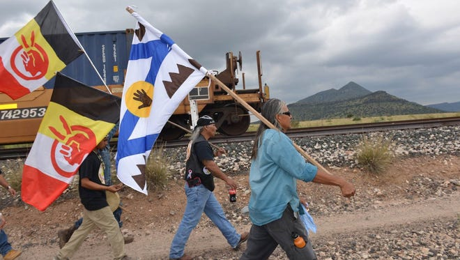 Roberto Lujan from Presidio and members of the American Indian Movement of Central Texas March through Alpine, Texas in protest of a pipeline being built in area.
