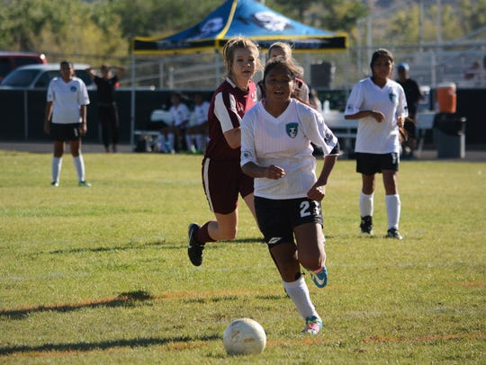 Navajo Prep's Kalieyah Boyd, front, goes on the attack