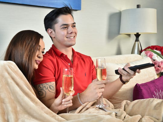 In the mood this year to save some cash? Get comfy with some Netflix and chill-ed champagne for an intimate night in that also shows love for your wallet.  Jose Untalan and April Schacher in the Dusit Thani presidential suite on Jan. 12.