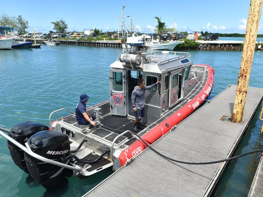 Guam Fire Departmet's Rescue II docks after transporting two persons found floating in the waters near Ritidian Point on Oct. 22. The condition of the two hadn't been released as of 5 p.m. Saturday.
