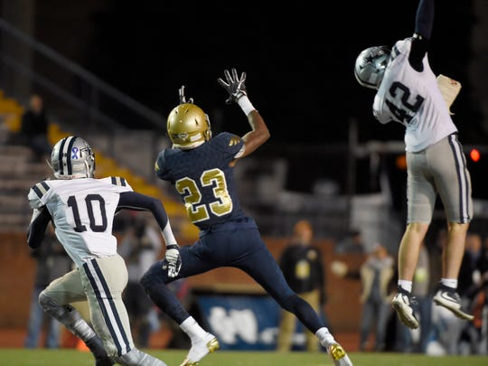 Farragut's Drew Butler (42) intercepts a pass for Independence's
