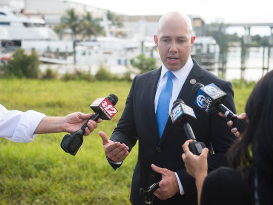 U.S. Rep. Brian Mast speaks Wednesday, Aug. 16, 2017 at a news conference at American Custom Yachts in Stuart, several days before he introduced the South Florida Clean Coastal Water Act.