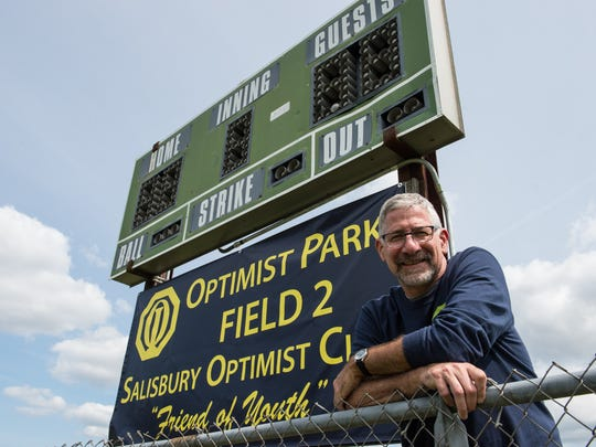 Mike DeFiore president of the Optimist Club of Salisbury poses for a photo at Prince Street Elementary baseball field on Monday, Sept. 11, 2017.