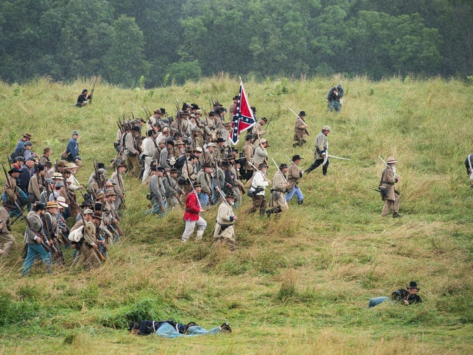 Confederate soldiers participate in a re-enactment