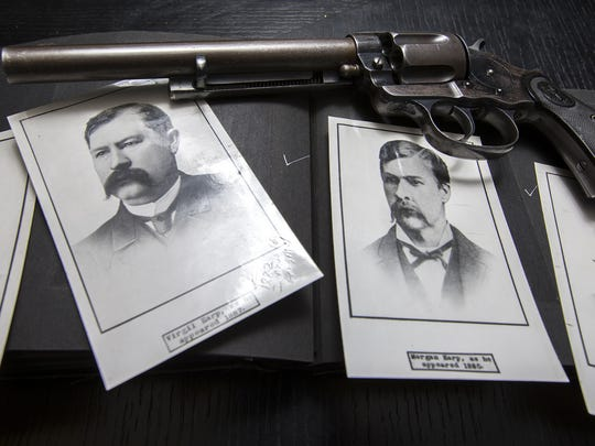The items pictures are from the many personal effects from Wyatt Earp and his family, including Virgil Earps's Colt pistol and a photo album with pictures of the Earp brothers - (L-R) James, left, Virgil, Morgan and Wyatt .