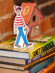 "A figure of Waldo from the popular Where's Waldo book series Monday, July 10, 2017, at Main Street Books, 426 Main Street in downtown Lafayette. Main Street Books has launched a shop local ""Where's Waldo"" campaign in which contestants can look for the Waldo figure in a scavenger hunt at local businesses. A variety of Where's Waldo books are available as prizes."