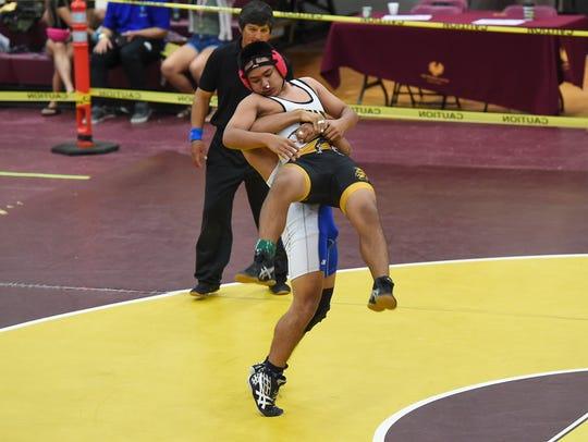 Southern High's Richard Chargualaf lifts Tiyan's Jowan