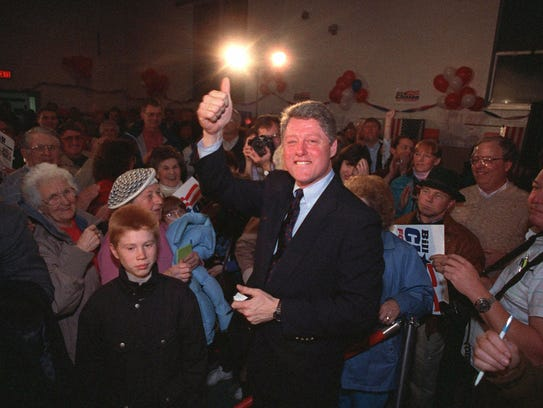 Bill Clinton gives a thumbs-up on Feb. 13, 1992, during