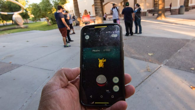 """Pokémon Go"" players search for Pokémon on Saturday, July 10, 2016, at New Mexico State University. The mobile game, released Wednesday, has vaulted to the top of the app charts, and many in Las Cruces are playing it daily."