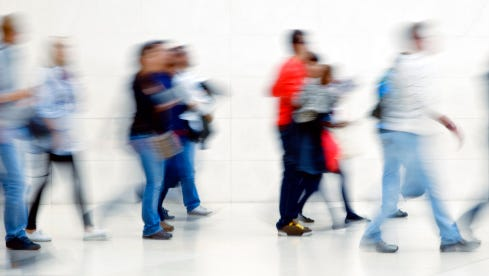 Young People Walking Down Hallway, High Key, Blurred Motion