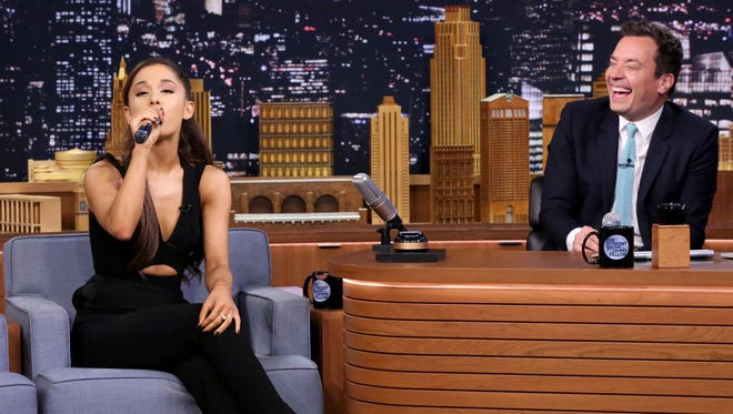 "Singer Ariana Grande and host Jimmy Fallon play ""Wheel of Musical Impressions"" on September 15, 2015."