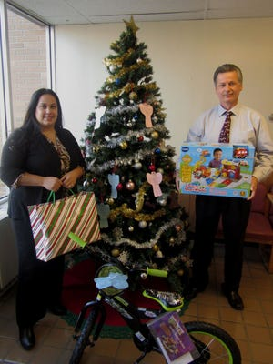 Lizzy Kennedy of the YMCA of Vineland and Alex Kaganzev, Project Santa coordinator, display some of the gifts donated as part of the YMCA's Angel Tree project.