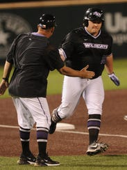 Koby Claborn, right, is congratulated by ACU coach