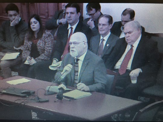 Ball State trustee Mike McDaniel, front row right,