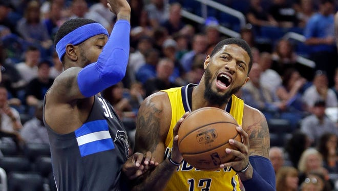 Indiana Pacers' Paul George (13) tries to get position to shoot against Orlando Magic's Terrence Ross during their game Saturday in Orlando.
