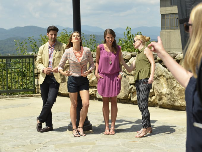 Asheville Outlets is holding its first photo shoot this week at the Grove Park Inn and in the River Arts District. Styled by Lydia Santangelo out of Boston, photographed by Montana Pritchard of West Palm Beach, Fla., the shoot involved local models and clothes from some of the 75 or so manufacturers' and retail shops that will be at Asheville Outlets when it opens in Spring 2015. July 29, 2014. Paul Clark (bigfun1@charter.net)