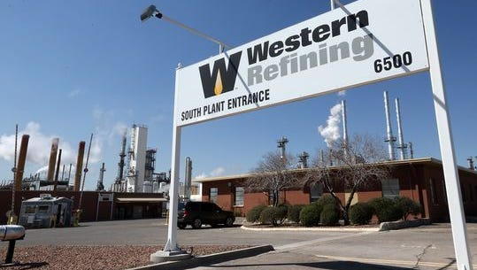 El Paso's Western Refining posted a $21 million profit in the first quarter as it awaits completion of its pending sale to Tesoro Corp. of San Antonio.