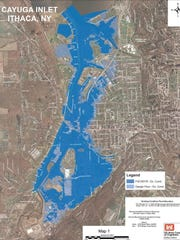 A flood map showing Ithaca if a 100-year storm were to strike before inlet dredging is complete. The flood control channel was designed to contain a storm larger than a 100-year storm, indicated by the light blue flood areas on the map.