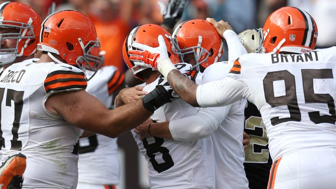 Browns players mob K Billy Cundiff (8) after his game-winning FG.