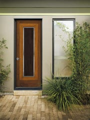 Welcome holiday guests with a custom wood door, such as this African Mahogany door by JELD-WEN.