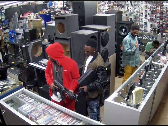 Gun theft suspects caught surveillance.