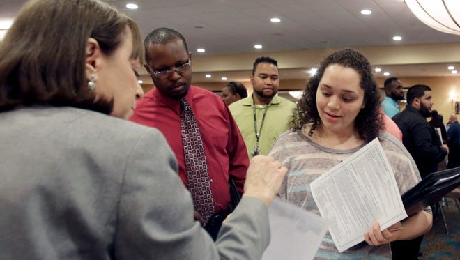 Activity at career fairs has been brisk as many Americans switch jobs.