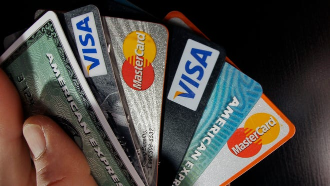 Consumer credit cards are posed in North Andover, Mass.
