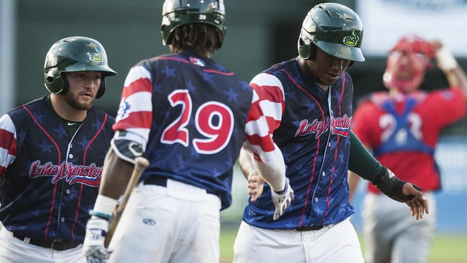 Vermont's JaVon Shelby (29) congratulates Miguel Mercedes (7) as he crosses the plate for a run during the baseball game between the Williamsport Crosscutters and the Vermont Lake Monsters at Centennial Field on Thursday night July 14, 2016 in Burlington.
