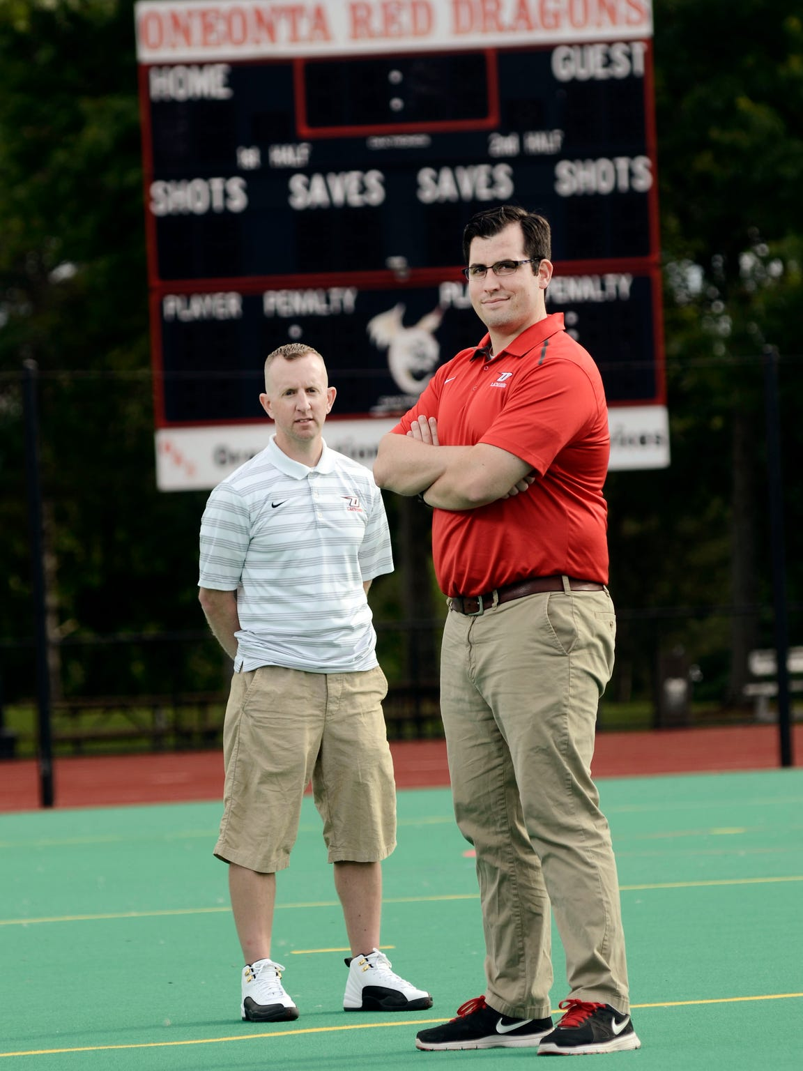 Oneonta lacrosse coach Dan Mahar, left, took a stand against homophobic language in his program and it helped save former player Andrew McIntosh's life.