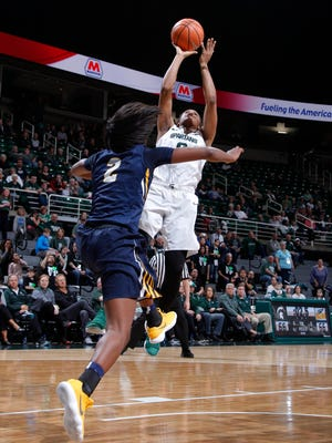 Michigan State's Shay Colley, right, gets the game-winning shot against Toledo's Mikaela Boyd (2), Monday, March 19, 2018, in East Lansing, Mich. MSU won 68-66.