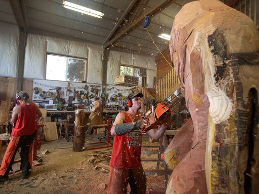 Tyler Strauslin works on a 19-foot Sasquatch at the