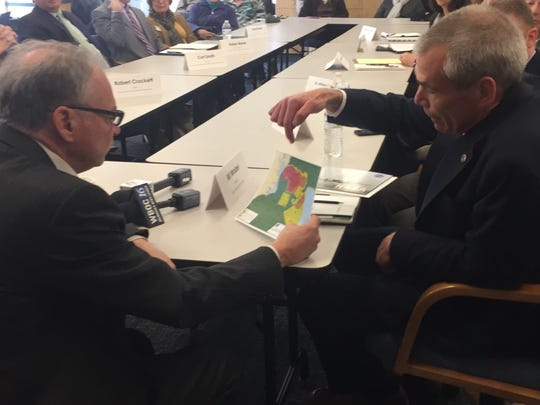 Bill Wrobel, director of NASA Wallops Flight Facility, shows Sen. Tim Kaine a map of rocket launch hazard zones  during a roundtable discussion about offshore oil drilling at the Virginia Institute of Marine Science Eastern Shore Laboratory in Wachapreague, Virginia on Monday, April 9, 2018.