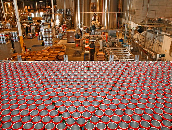 Empty cans are moved through the canning line at the