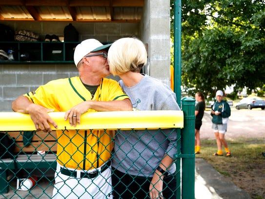 Gehlen Catholic baseball coach Marty Kurth gives wife
