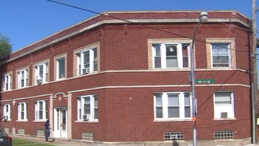 A photo taken from video shows a building where a boy was allegedly handcuffed in a basement.