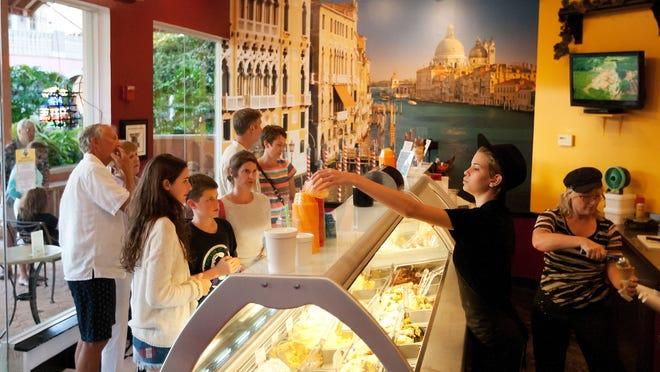 Emily Diaz, 18, serves customers Thursday at Divino Gelato Cafe at The Promenade at Bonita Bay.