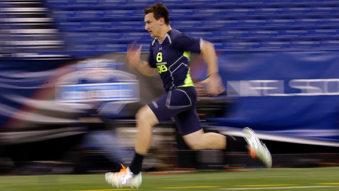 Texas A&M quarterback Johnny Manziel runs the 40-yard dash at the NFL football scouting combine in Indianapolis, Sunday, Feb. 23, 2014. (AP Photo/Michael Conroy) ORG XMIT: INMC101
