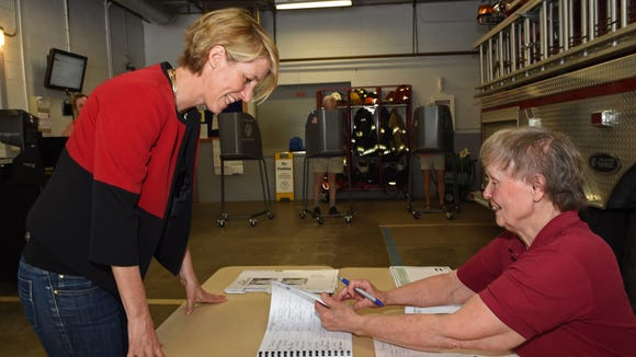 Poll worker Marjorie Fountain of Clinton Corners checks in Democratic congressional candidate Zephyr Teachout at the East Clinton Fire District in Clinton Corners during the June 28 primary election.