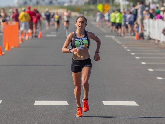 Amanda Marino of Jackson heads to the finish line of