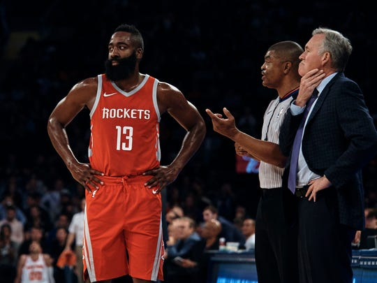 Houston Rockets' James Harden (10) and coach Mike D'Antoni talk to the referee during the first half of a preseason NBA basketball game at Madison Square Garden in New York, Monday, Oct. 9, 2017.