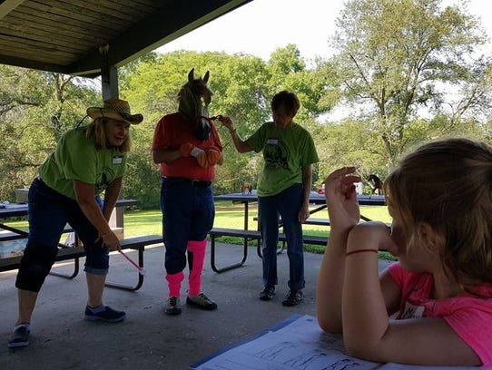 Instructor Sandy Rogers (left) points out Unicorn's