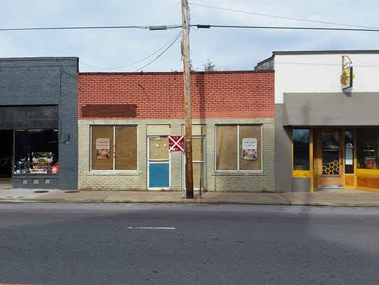 This building at 715 Haywood Road will soon be the