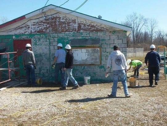 Members of the Blue Water Building Trades donated time to renovate the Port Huron Township Little League facilities in the spring of 2017.