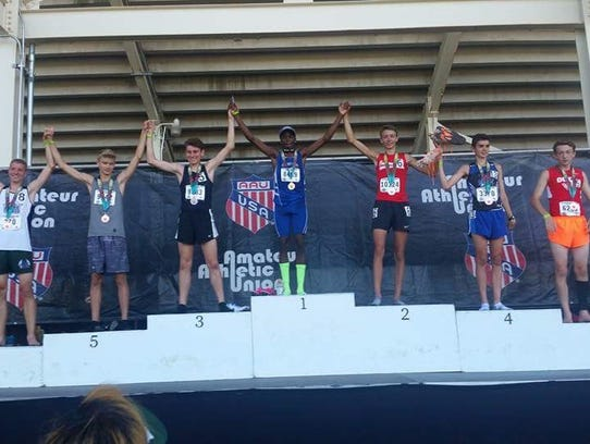 Jaron Jordan enjoys his medal ceremony at the AAU championships