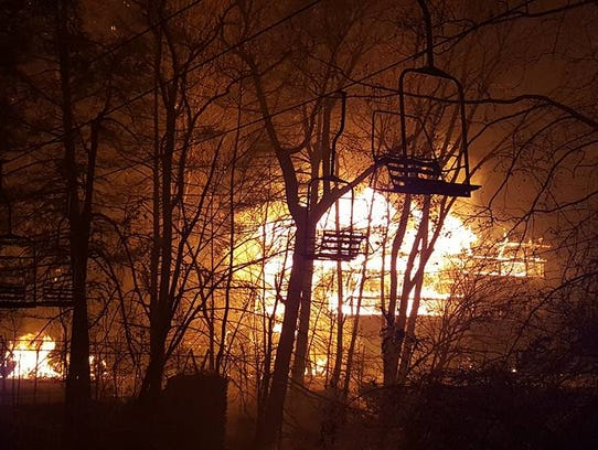 Flames destroy the Riverhouse motel at the corner of