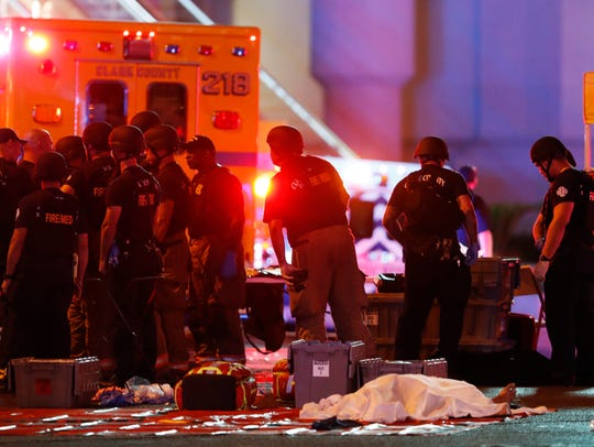 A body is covered with a sheet after a mass shooting