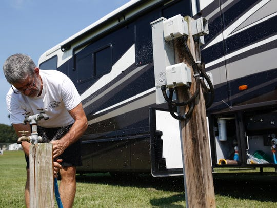 Ron Roswell hooks up his RV at North Florida Fairgrounds Sep 7 after driving through the night. Roswell, his wife, their daughter and two dogs plan to wait out the storm in Tallahassee.